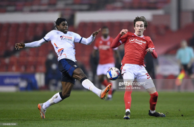 <div>Nottingham Forest v Luton Town - Sky Bet Championship</div><div><br></div><div>NOTTINGHAM, ENGLAND - MARCH 02: James Garner of Nottingham Forest battles for possession with Pelly-Ruddock Mpanzu of Luton Town during the Sky Bet Championship match between Nottingham Forest and Luton Town at City Ground on March 02, 2021 in Nottingham, England. Sporting stadiums around the UK remain under strict restrictions due to the Coronavirus Pandemic as Government social distancing laws prohibit fans inside venues resulting in games being played behind closed doors. (Photo by Laurence Griffiths/Getty Images)</div>