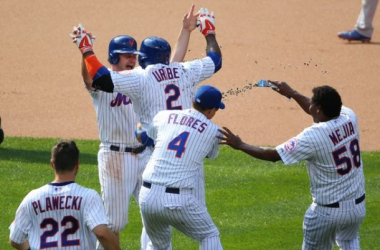 Juan Uribe celebrates with teammates after his walk-off single in the 10th inning -- Anthony Gruppuso/USA TODAY Sports