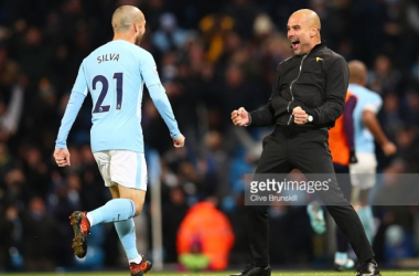 MANCHESTER, ENGLAND - NOVEMBER 29: Josep Guardiola, Manager of Manchester City celebrates his sides second goal with David Silva of Manchester City during the Premier League match between Manchester City and Southampton at Etihad Stadium on November 29, 2