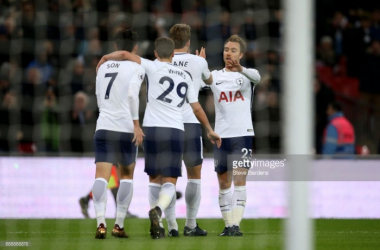 Tottenham Hotspur players celebrate after scoring against Stoke City on Saturday