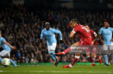 Bobby Reid dispatching a penalty in the Carabao Cup semi-final vs Manchester City/Credit: Gareth Copley