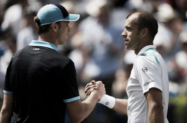 Sam Querrey and Gilles Muller shake hands (Photo: Reuters)