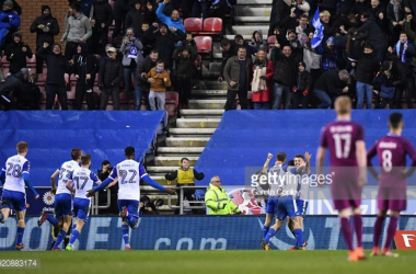 WIGAN, ENGLAND - FEBRUARY 19: William Grigg of Wigan Athletic celebrates with teammates after scoring his sides first goal during the Emirates FA Cup Fifth Round match between Wigan Athletic and Manchester City at DW Stadium on February 19, 2018 in Wigan,