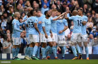 MANCHESTER, ENGLAND - APRIL 22: Kevin De Bruyne of Manchester City celebrates scoring his side's third goal with team mates during the Premier League match between Manchester City and Swansea City at Etihad Stadium on April 22, 2018 in Manchester, En