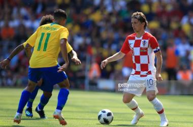 Luka Modric weighing up his options versus Brazil/ Credit: David Blunsden