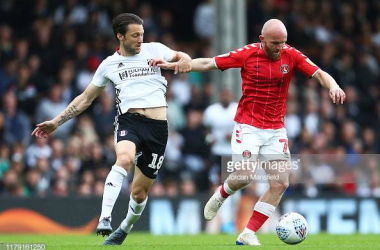 LONDON, ENGLAND - OCTOBER 05: Harry Arter of Fulham tackles with Jonny Williams of Charlton during the Sky Bet Championship match between Fulham and Charlton Athletic at Craven Cottage on October 05, 2019 in London, England. (Photo by Jordan Mansfield/Getty Images)