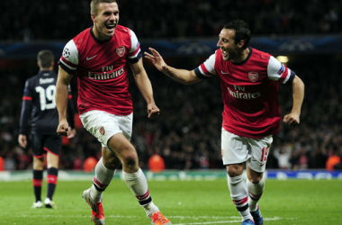 Lukas Podolski celebrates after firing in the Gunners' second goal