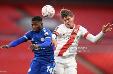 LONDON, ENGLAND - APRIL 18: Kelechi Iheanacho of Leicester City battles for possession with Jannik Vestergaard of Southampton during the Semi Final of the Emirates FA Cup match between Leicester City and Southampton FC at Wembley Stadium on April 18, 2021 in London, England. 4000 local residents have been permitted to attend the match as part of the government's Events Research Programme, which will study how to safely hold major events once coronavirus lockdown measures are eased. Other sporting events around the United Kingdom continue to be played behind closed doors. (Photo by Michael Regan - The FA/The FA via Getty Images)