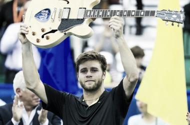 A tearful Harrison hoists the famous guitar (Photo: Press Association)