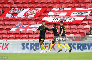 Ollie Watkins of Brentford celebrates scoring a goal with team mates during the Sky Bet Championship match between Barnsley  and Brentford at Oakwell Stadium on September 29, 2019 in Barnsley, England. (Photo by Jan Kruger/Getty Images)