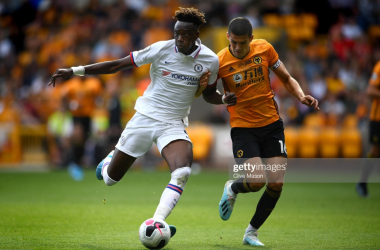 WOLVERHAMPTON, ENGLAND - SEPTEMBER 14: Tammy Abraham of Chelsea competes with Conor Coady of Wolverhampton Wanderers during the Premier League match between Wolverhampton Wanderers and Chelsea FC at Molineux on September 14, 2019 in Wolverhampton, United Kingdom. (Photo by Clive Mason/Getty Images)
