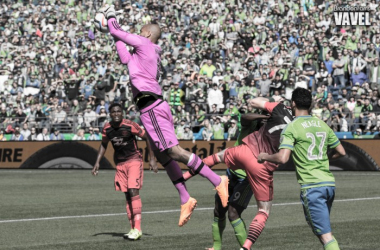 Adam Kwarasey leaps into the air to collect a ball during a game against the Seattle Sounders | Brandon Farris - VAVEL USA
