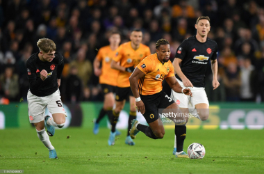 WOLVERHAMPTON, ENGLAND - JANUARY 04: Adama Traore of Wolverhampton Wanderers breaks away from Brandon Williams and Nemanja Matic of Manchester United during the FA Cup Third Round match between Wolverhampton Wanderers and Manchester United at Molineux on January 04, 2020 in Wolverhampton, England. (Photo by Shaun Botterill/Getty Images)