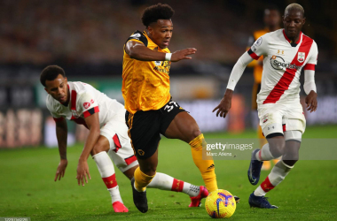 Adama Traore skips past Ryan Bertrand and Moussa Djenepo during Southampton's last visit to Molineux in November. (Photo by Marc Atkins/Getty Images)