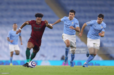 Adama Traore looks to escape from Rodri and Ruben Dias during Wolves' 4-1 defeat to Manchester City. (Photo by Jack Thomas - WWFC/Wolves via Getty Images)