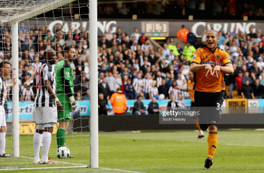 Adlene Guedioura wheels away having put Wolves 2-0 up against West Brom. (Photo by Scott Heavey/Getty Images)