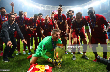 Liverpool players and their new Spanish goalkeeper celebrate their European Super Cup triumph in Istanbul (Getty Images)