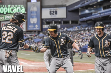 Danny Valencia (middle) celebrates after his go-ahead home run in the ninth inning. Photo: Bill Howard/VAVEL USA