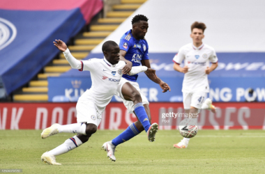 LEICESTER, ENGLAND - JUNE 28: N'Golo Kante of Chelsea battles for possession with Wilfred Ndidi of Leicester City during the FA Cup Fifth Quarter Final match between Leicester City and Chelsea FC at The King Power Stadium on June 28, 2020 in Leicester, England. (Photo by Rui Vieira/Pool via Getty Images)