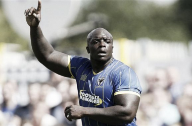 Akinfenwa signs new deal with AFC Wimbledon