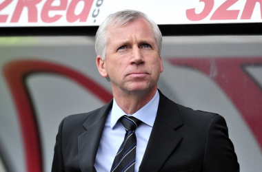 Alan Pardew can be seen to make comments playing down success.