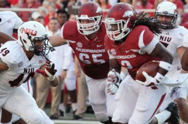 Alex Collins was not overwhelming, but he was effective with 79 yards on the ground (Danny Johnston / AP Photo)