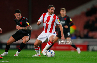 Joe Allen competes with Alex Mowatt during the Sky Bet Championship match between Stoke City and West Bromwich Albion at the Bet365 Stadium on October 01, 2021. (Photo by Malcolm Couzens/Getty Images)