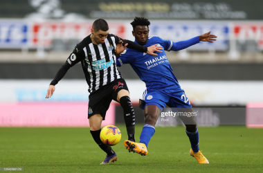 Miguel Almiron of Newcastle United (L) is tackled by Wilfred Ndidi of Leicester City (R) during the Premier League match between Newcastle United and Leicester City at St. James Park on January 03, 2021 in Newcastle upon Tyne, England. (Photo by Lee Smith - Pool/Getty Images)