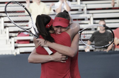 Canadians Carson Branstine and Bianca Andreescu embrace after their huge three-set victory over Kristina Mladenovic and Anastasia Pavlyuchenkova in the first round of the 2017 Rogers Cup. | Photo: Max Gao