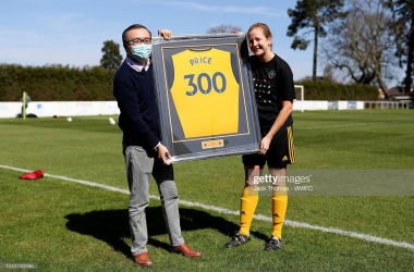 Anna price was presented with a framed shirt with 300 on the back by Wolves owner Jeff Schi in the FA Women's Cup win over Nottingham Forest. (Photo by Jack Thomas - WWFC/Wolves via Getty Images)