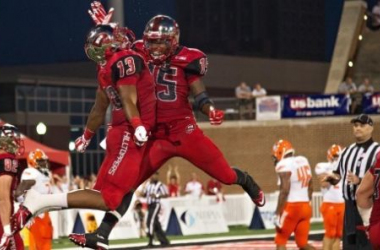 Antwane Grant and Nicholas Norris celebrate a Western Kentucky touchdown (USA Today Sports)