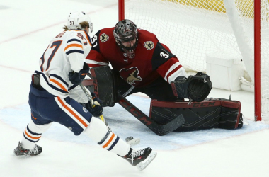 McDavid moves past Adin Hill (Photo: AP Photo/Ross D. Franklin)