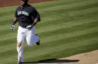Nelson Cruz rounding third after his first home run in a Mariners uniform (AP Photo/Charlie Riedel)