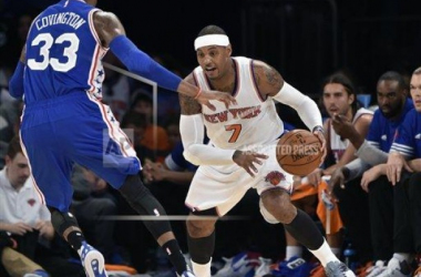 Knicks' Carmelo Anthony drives past Sixers' Robert Covington AP Images-Kathy Kmonicek