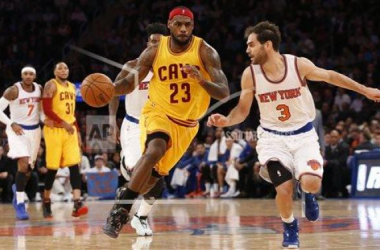 Cavaliers' LeBron James dribbles past Knicks' Jose Calderon and drives to the basket. AP Images-Kathy Willens