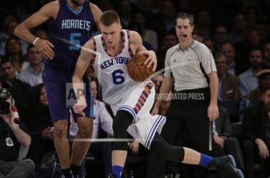 Knicks' Kristaps Porzingis dribbles past Hornets' Nicolas Batum AP Images-Julie Jacobson