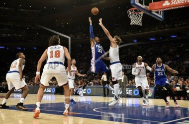 Knicks Robin Lopez tries to block Sixers Robert Covington shot. AP Photo/Kathy Kmonicek