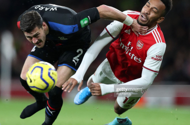 LONDON, ENGLAND - OCTOBER 27: Pierre-Emerick Aubameyang of Arsenal is brought down by Joel Ward of Crystal Palace during the Premier League match between Arsenal FC and Crystal Palace at Emirates Stadium on October 27, 2019 in London, United Kingdom. (Photo by Alex Morton/Getty Images)