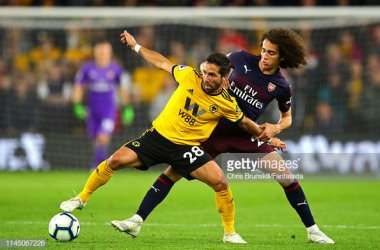 <div>WOLVERHAMPTON, ENGLAND - APRIL 24: Joao Moutinho of Wolverhampton Wanderers in action with Matteo Guendouzi of Arsenal during the Premier League match between Wolverhampton Wanderers and Arsenal FC at Molineux on April 24, 2019 in Wolverhampton, United Kingdom. (Photo by Chris Brunskill/Fantasista/Getty Images)</div>