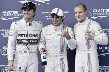 Massa (centre) claimed his first pole since his life-threatening accident in Hungary