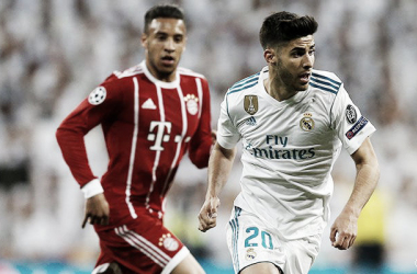 Asensio ante Tolisso en un Real Madrid - Bayern   Foto: realmadrid.com