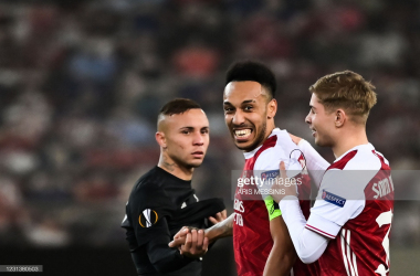 Arsenal's English midfielder Emile Smith Rowe (R) and Arsenal's Gabonese striker Pierre-Emerick Aubameyang (C) celebrate at the end of the UEFA Europa League 32 Second Leg football match between Arsenal and Benfica at the Karaiskaki Stadium in Athens, on February 25, 2021. (Photo by ARIS MESSINIS / AFP) (Photo by ARIS MESSINIS/AFP via Getty Images)