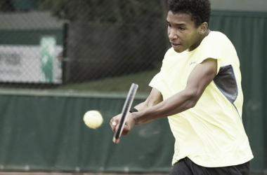 Félix Auger-Aliassime hits a backhand at the French Open. Photo: Susan Mullane/ITF