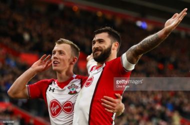 Charlie Austin celebrates the opener against Huddersfield