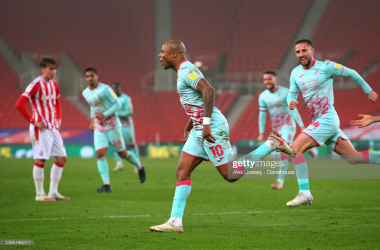 Andre Ayew celebrates his 95th minute winning penalty at the Bet365 Stadium | (Photo by Alex Livesey - Danehouse/Getty Images)