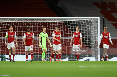 <div>Arsenal FC v Slavia Praha - UEFA Europa League Quarter Final: Leg One</div><div>LONDON, ENGLAND - APRIL 08: Players of Arsenal looks dejected after conceding their side's first goal scored by Tomas Holes of Slavia Praha (not pictured) during the UEFA Europa League Quarter Final First Leg match between Arsenal FC and Slavia Praha at Emirates Stadium on April 08, 2021 in London, England. Sporting stadiums around Europe remain under strict restrictions due to the Coronavirus Pandemic as Government social distancing laws prohibit fans inside venues resulting in games being played behind closed doors. (Photo by Julian Finney/Getty Images)</div>