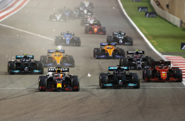 The grid races towards turn one. (Photo by Bryn Lennon/Getty Images)