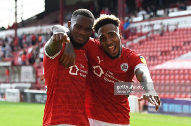 Dimitri Cavare and Mallik Wilks celebrate during Barnsley's opening-day win over Fulham. Photo by George Wood/Getty Images.
