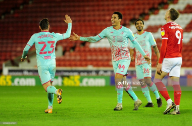 Swansea City's Ben Cabango celebrates his goal with provider Connor Roberts. Photo: Athena Pictures/Getty Images.