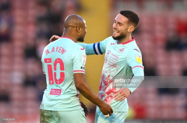 Swansea City's Andre Ayew celebrates his goal with Matt Grimes. Photo: Laurence Griffiths/Getty Images.